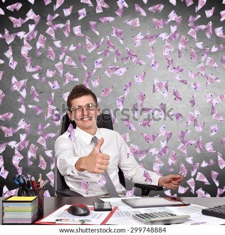 businessman showing thumb up and falling euro bills - stock photo