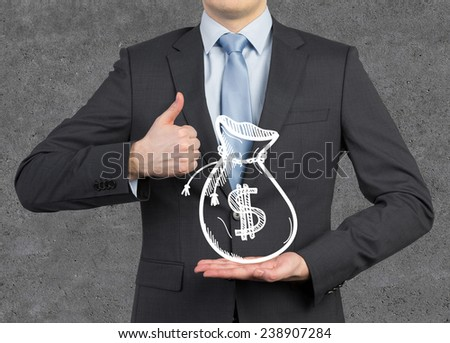 businessman showing  thumb up and holding drawing money bags