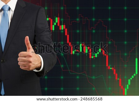 businessman showing  thumb up and stock chart on virtual screen - stock photo