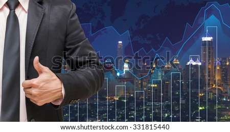 businessman showing thumb up on Trading graph on the cityscape at night and world map background,Business financial concept - stock photo