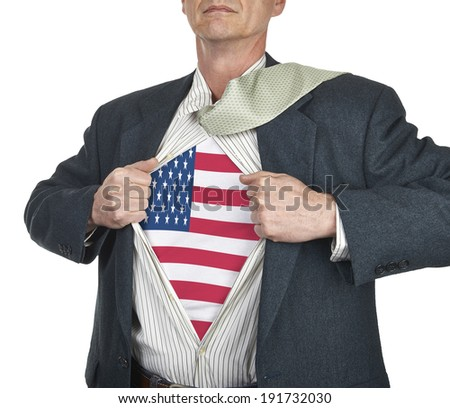 Businessman showing USA flag superhero suit underneath his shirt standing against white background - stock photo
