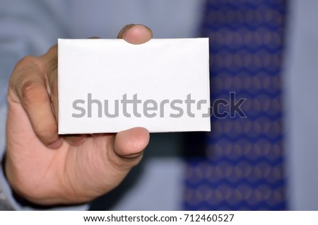 Businessman showing white blank card