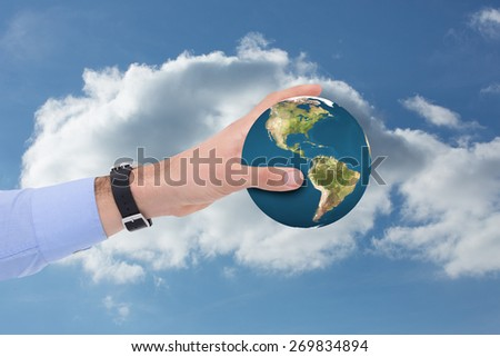 Businessman showing with his hand against cloudy sky - stock photo