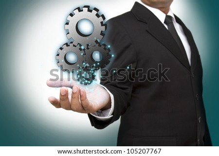 Businessman shows gear to success