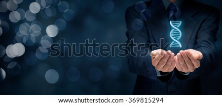 Businessman shows he has genes (talent, natural ability, aptitude) for business (represented by DNA symbol). Wide banner composition with bokeh in background.