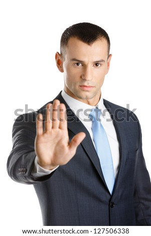 Businessman shows stop gesture, isolated on white - stock photo