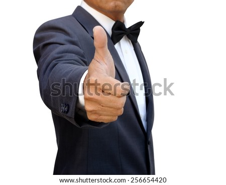businessman shows thumb isolated with path - stock photo