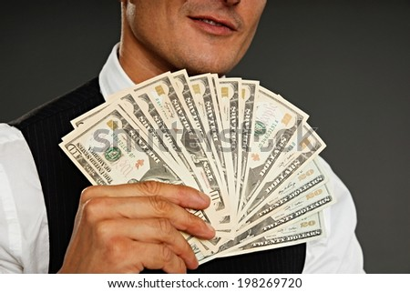 Businessman shows you money, focus is on money