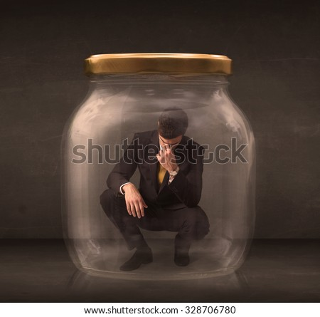 Businessman shut into a glass jar concept on background - stock photo