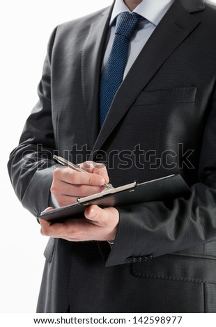 Businessman signing a contract, closeup shot