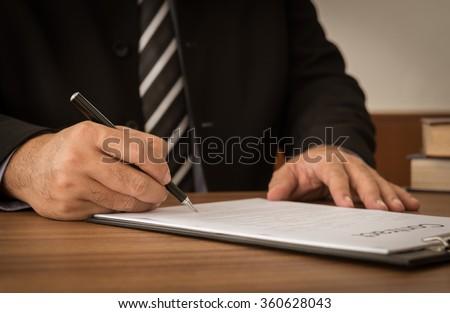Businessman signing a joint venture agreement or business deals. Concept of signing contract.