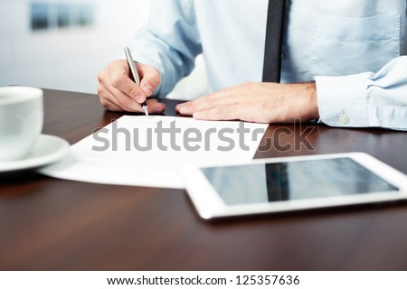 Businessman signing contract.