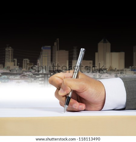 Businessman signing document - stock photo