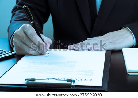 businessman signing marketing contract. - stock photo