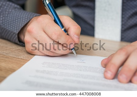 Businessman signing successful conclusion of the business contract