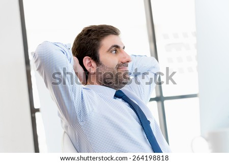 Businessman sitting and relaxing in office  - stock photo