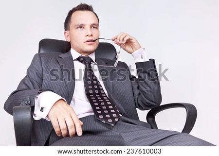 Businessman sitting and thinking