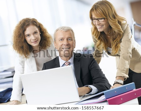 Businessman sitting and working on a laptop in the office