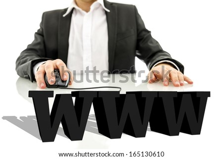 Businessman sitting at his desk surfing the net. Virtual 3d www sign on his desk. Internet concept. - stock photo