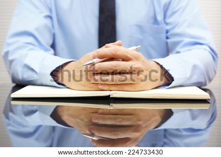 Businessman sitting at his office and interrogated his client - stock photo