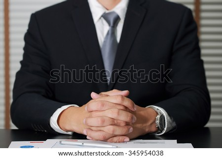 Businessman sitting at meeting room to hear the detail as business concept.