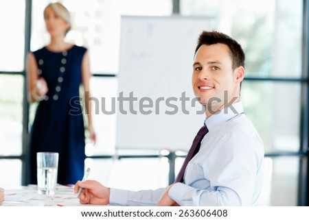 Businessman sitting at presentation