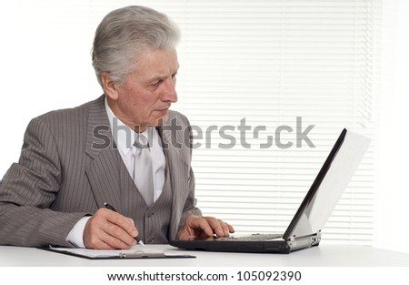 Businessman sitting at the computer on a background