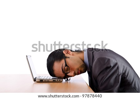 Businessman sitting at the desk - stock photo
