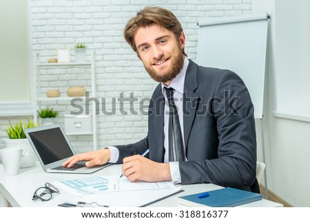 Businessman sitting at the table and working