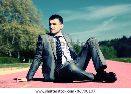 businessman sitting down with special photographic processing - stock photo
