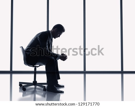 businessman sitting in a chair in office