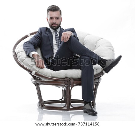 Elegant man business suit sitting studio stock photo for Sitting easy chairs