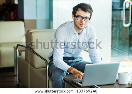 businessman sitting in cafe - stock photo