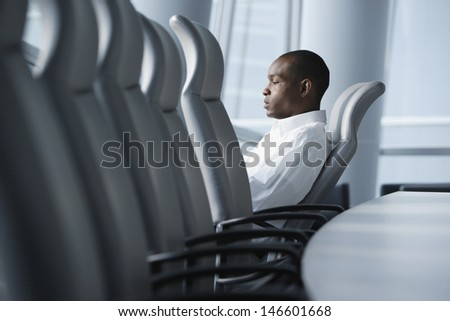 Businessman sitting in conference room
