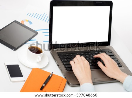 Businessman sitting in front of computer monitor and analyzing data - stock photo