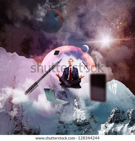 Businessman sitting in lotus flower position against space background with office stuff aloft - stock photo