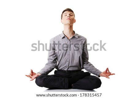 Businessman sitting in lotus position, Isolated on white background