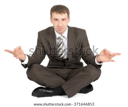 Businessman sitting in lotus posture