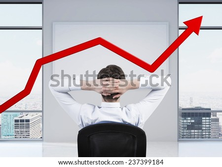 businessman sitting in office and looking to red arrow
