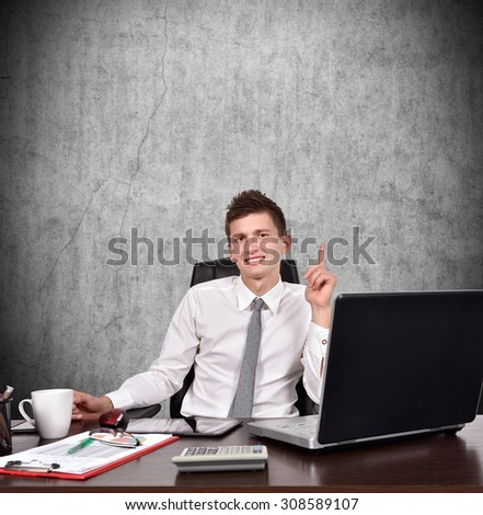 businessman sitting in office and showing finger up