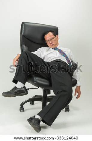 Businessman sitting in office chair  on white background