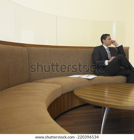 Businessman sitting in waiting room - stock photo