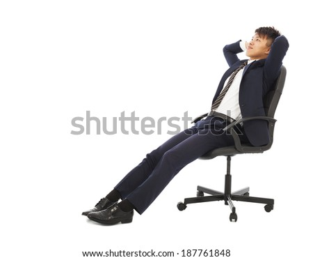 businessman sitting on a chair and holding head - stock photo