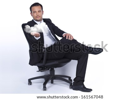 Businessman sitting on a chair and presents cloud technology - stock photo
