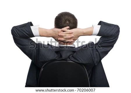 Businessman sitting on a chair in a relaxed state. - stock photo