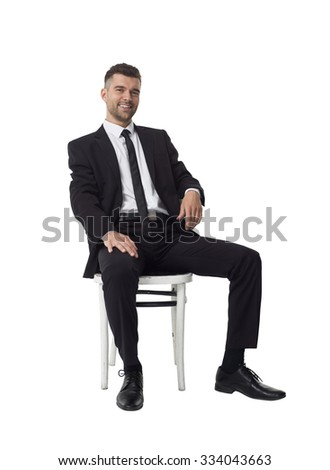 Businessman sitting on chair Full Length Portrait isolated on White Background