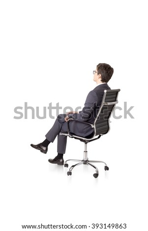 Businessman sitting on chair. Side view. Isolated. Concept of work.