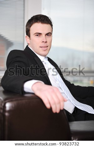 Businessman sitting on sofa in office