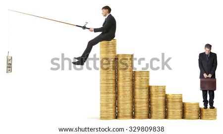 Businessman sitting on stack of coins rock and fishing