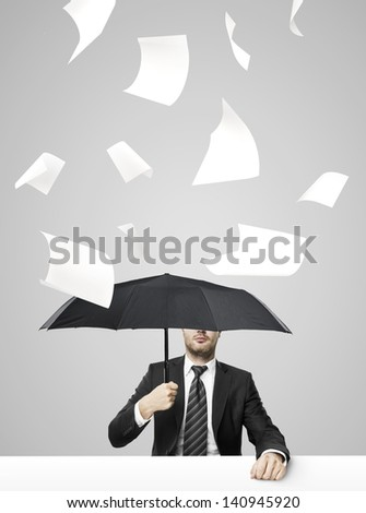 businessman sitting on table with umbrella